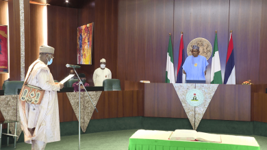 Photo of Buhari Swears in Prof Yakubu for Second Tenure