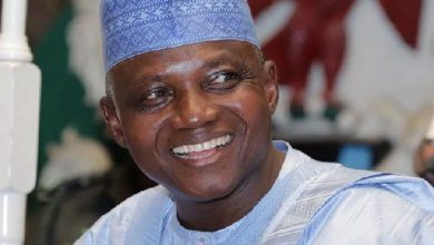 Photo of President Spokesman, Garba Shehu Under Fire For Hugging a Woman